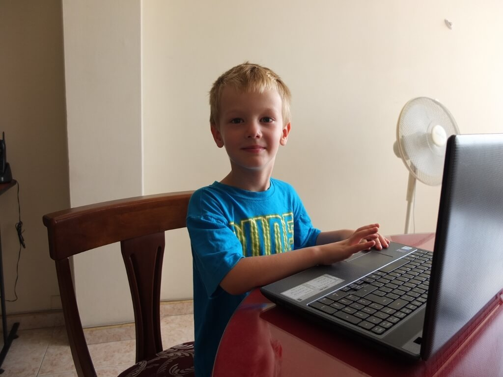 Mak doing a little homeschooling - How to travel long term with kids