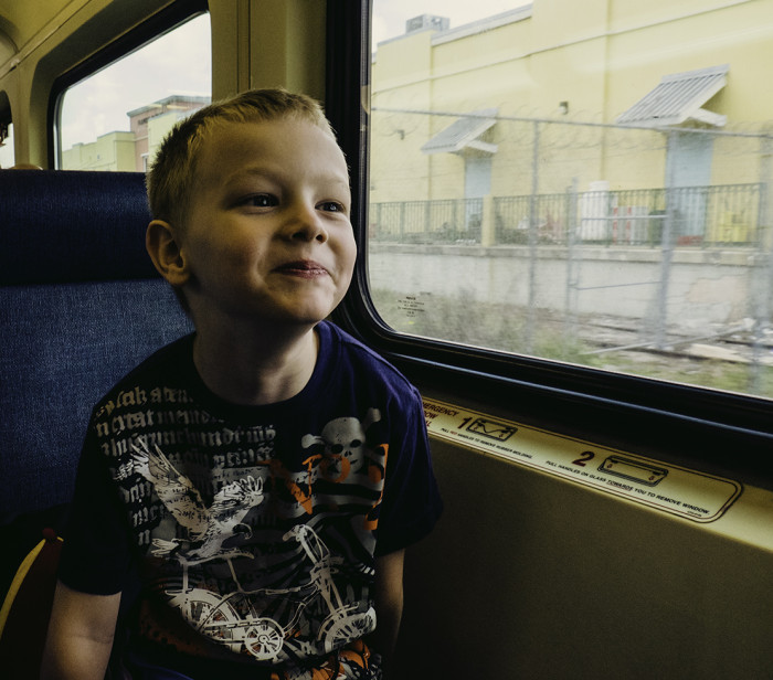 Makai, excited to be on the train on route to catch our plane to Colombia