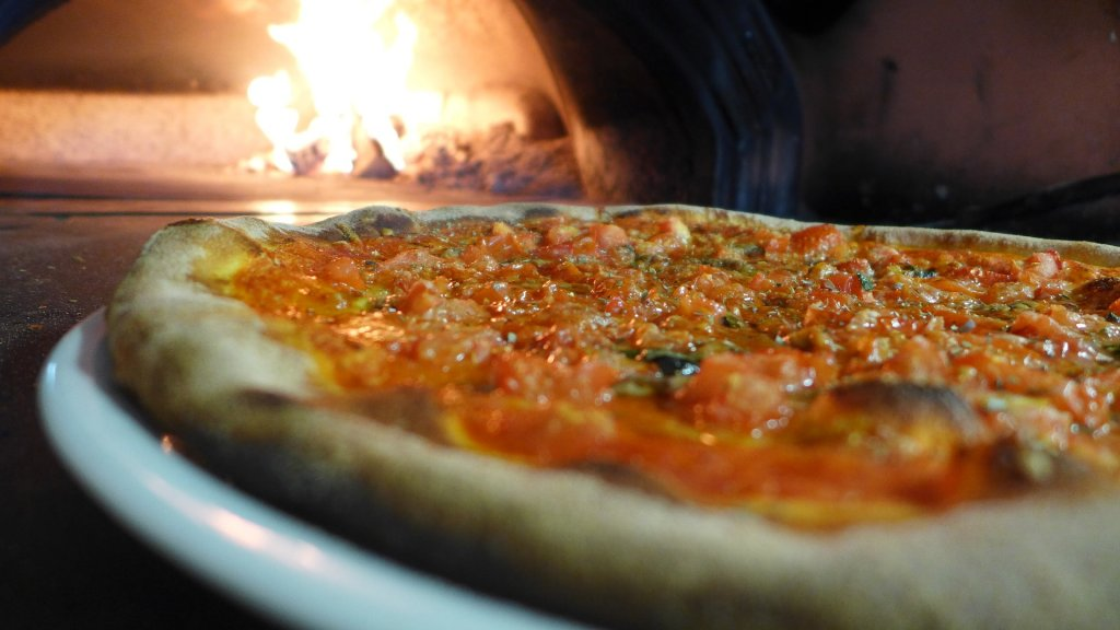 Best pizza in Puerto Vallarta- authentic stone oven bake pizza at Los Muertos Brewing